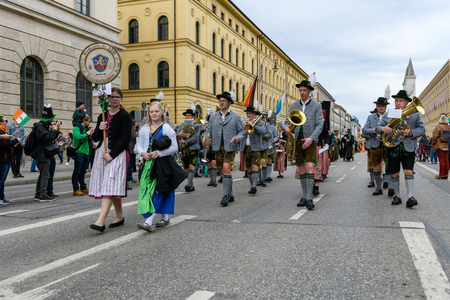 MUNICH, BAVARIA, GERMANY -  MARCH 11, 2018: Focus on band front man in traditional Bavarian clothing men at the St. Patricks Day Parade. The name of the music band is Blaskapelle Unterpaffenhofen. Editöryel