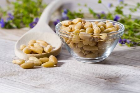 Group of pine nuts with spoon in cooking environment. Stok Fotoğraf - 146955912