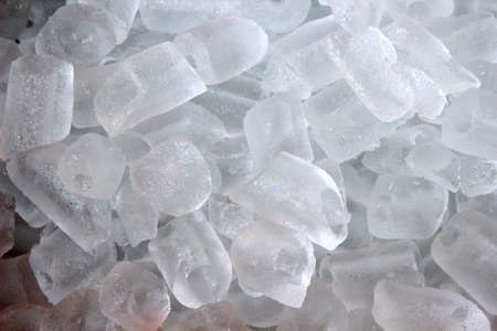 inflexible: frozen water, a brittle, transparent crystalline solid. Ice cubes to the water cooler. Refresh Stock Photo