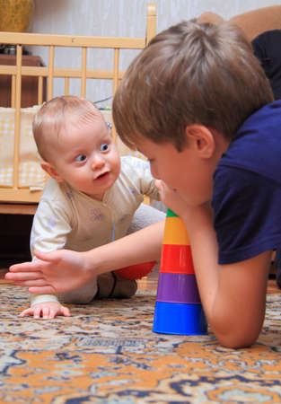 two brothers play at home photo