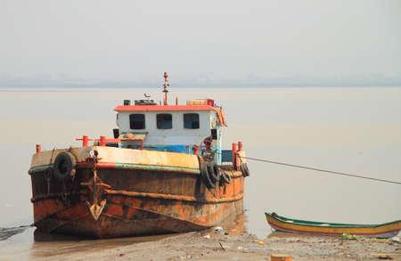 india fisherman: fishing boat in surburb of Mumbai, India