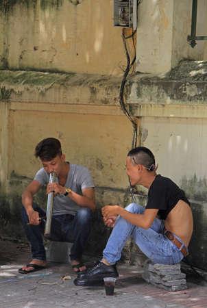 contingent: Hanoi, Vietnam - June 2, 2015: two guys are smoking something