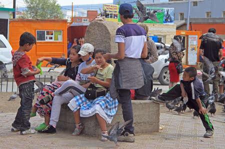 lazybones: Ulaanbaatar, Mongolia - July 8, 2015: people are communicating on the square in Ulaanbaatar, Mongolia
