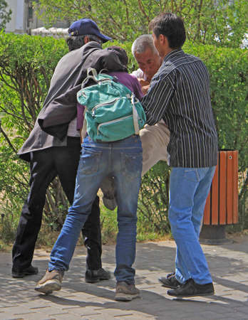 asbo: Ulaanbaatar, Mongolia - July 8, 2015: two guys are trying to separate two fighting men
