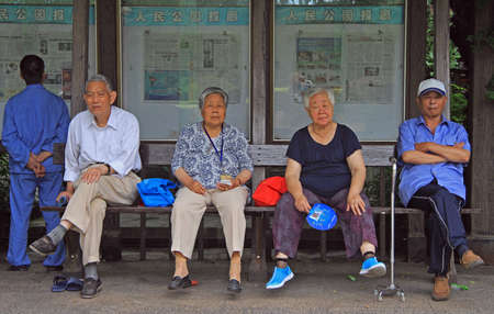 china people: Shanghai, China - July 1, 2015: people are resting in park of Shanghai, China