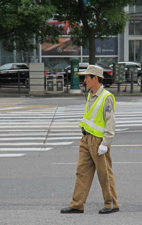 controling: Shanghai, China - July 2, 2015: traffic officer are controling street motion in Shanghai