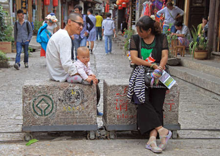 old asian: Lijiang, China - June 10, 2015: people are communicating on the street in Lijiang, China