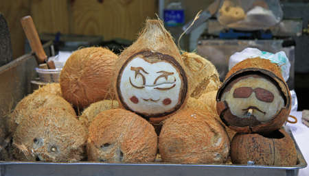 fag: painted coconuts with faces in Lijiang, China Stock Photo
