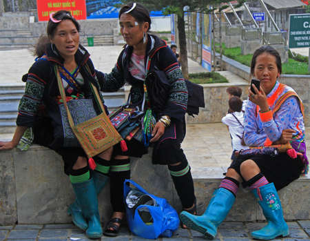 gum boots: Sa Pa, Vietnam - June 6, 2015: three women are sitting outdoor in Sa Pa, Vietnam Editorial