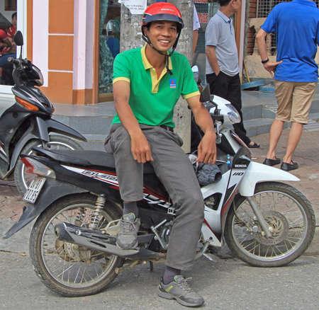 sa: Sa Pa, Vietnam - June 6, 2015: man is sitting on motorcycle outdoor in Sa Pa, Vietnam Editorial
