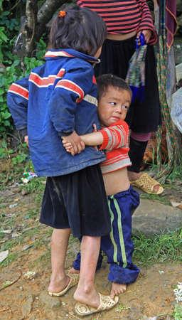 pa: Sa Pa, Vietnam - June 6, 2015: brother is hugging his sister oudoor in Sa Pa, Vietnam