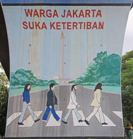 Jakarta, Indonesia - April 23, 2015: graffiti with reference to cover of Beatles album 'Abbey Road' in Jakarta, Indonesia