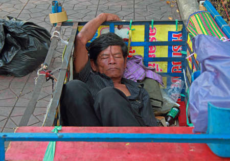 three wheeler: Bangkok, Thailand - March 19 2015: man is sleeping in trailor body, Bangkok, Thailand