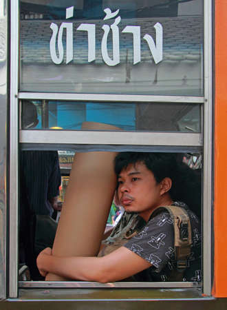 attractive girl: Bangkok, Thailand - March 20 2015: guy is riding to somewhere by bus in Bangkok, Thailand