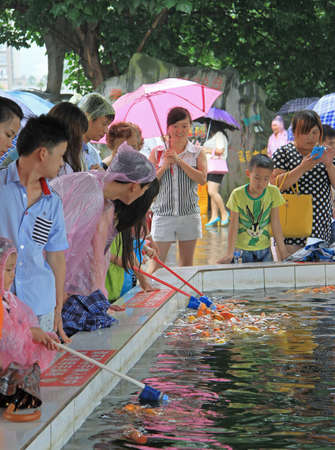 nipple man: people in park are watching for feding of fish, China