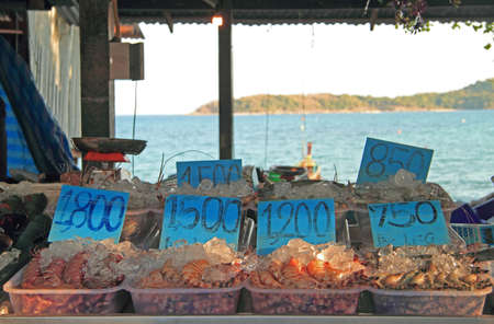 phuket food: shrimps, oysters and other seafood on the street market, Phuket island, Thailand Stock Photo