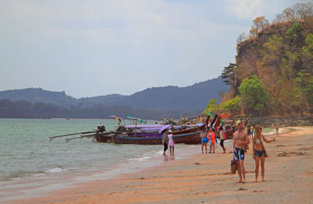 ao: Ao Nang beach, Thailand - March 29, 2015: people are walking by Ao Nang in Krabi province of Thailand Editorial