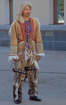 ulan ude: Ulan Ude, Russia - July 10, 2015: man of indigenous small numbered people is standing outdoor in Ulan Ude Editorial