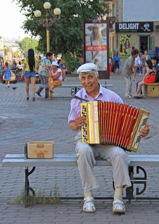 ulan ude: Ulan Ude, Russia - July 10, 2015: man is playing bayan outdoor in Ulan Ude, Russia