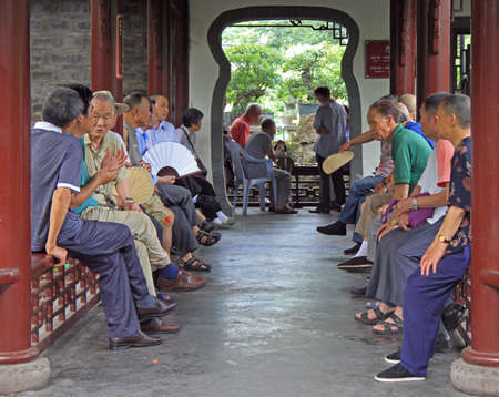 summerhouse: Chengdu, China - June 14, 2015: chinese people are sitting in pavilion in park of Chengdu Editorial