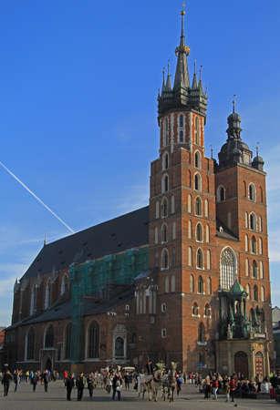 Krakow, Poland - October 29, 2015: people are walking nearly St. Marys Church, famous landmark in Krakow, Poland