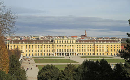 schoenbrunn: Vienna, Austria - November 10, 2015: people are walking nearly Schoenbrunn palace - former imperial summer residence