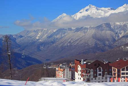 Krasnaya Polyana, Russia, Russia - February 2, 2016: hotel village at the ski resort, snowy Caucasian Mountains, Russia