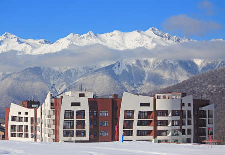 hotel village at the ski resort, snowy Caucasian Mountains, Russia