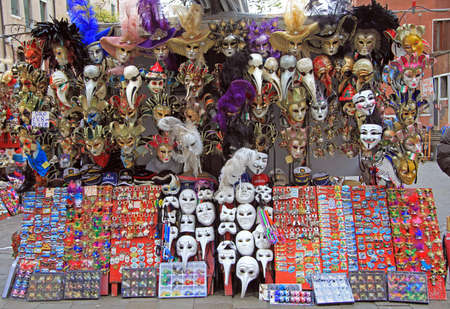 the merchant of venice: Venice, Italy - November 23, 2015: souvenirs and carnival masks outdoor in Venice, Italy