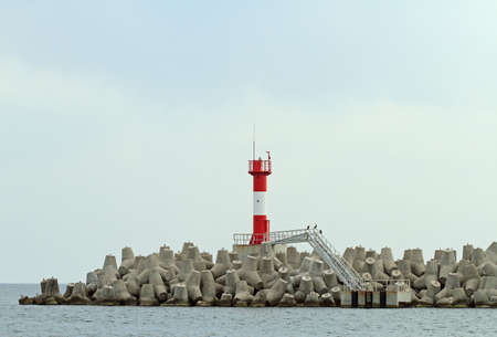 Concrete coastal fortifications in sea port of Sochi in Russia, view from the sea