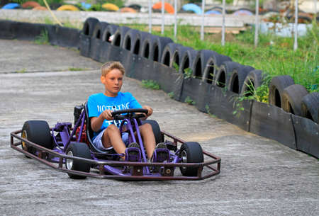 boy is driving a kart on kart circuit in Sochi, Russia Stock Photo