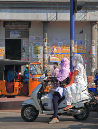 yashmak: Hyderabad, India - March 11, 2015: people are riding on motorcycle in Hyderabad, India Editorial