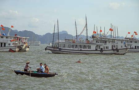 Ha Long bay, Vietnam - June 3, 2015: people are floating in boat by Ha Long bay, Vietnam Editorial