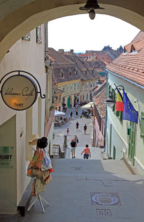 people are walking by the old town in Sibiu, Romania