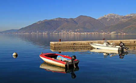 a few boats moored in bay of Tivat, Montenegro