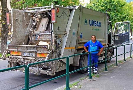 Brasov, Romania - July 25, 2017: worker is standing in front of garbage truckdoor in Brasov, Romania Sajtókép