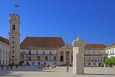 people are walking by university square in Coimbra, Portugal