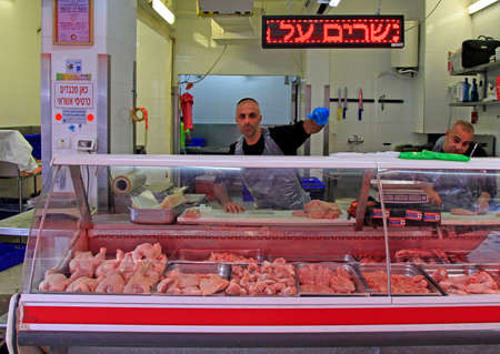 Tel Aviv, Israel - November 30, 2017: man sells meat at Carmel market in Tel Aviv, Israel