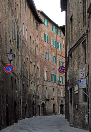 Siena, Italy - December 14, 2018: the narrow street in old town of italian city Siena