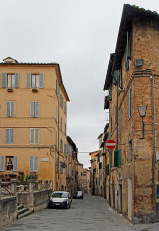 the narrow street in old town of italian city Siena