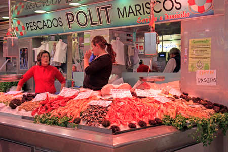 Valencia, Spain - April 26, 2018: women are selling seafood at central market in Valencia, Spain Editorial