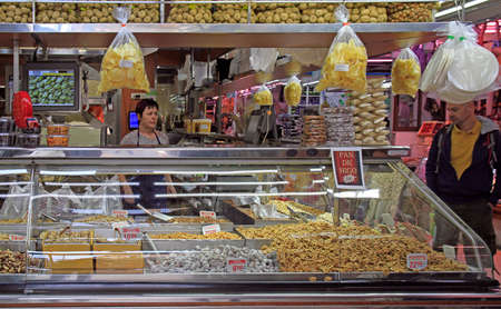 Valencia, Spain - April 26, 2018: stall with dried fruits and nuts at central market in Valencia