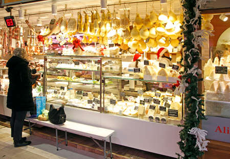 Turin, Italy - December 19, 2019: stall with cheese on city market in Turin, Italy Editorial