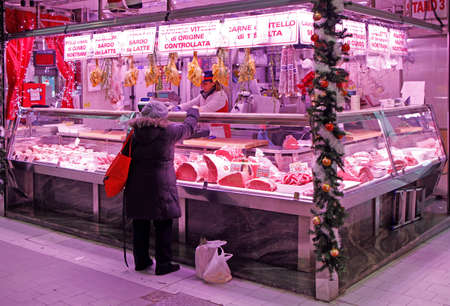 Turin, Italy - December 19, 2019: stall with fresh meat on city market in Turin, Italy