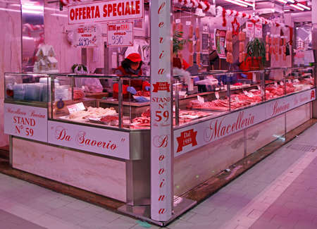 Turin, Italy - December 19, 2019: stall with fresh meat on city market in Turin