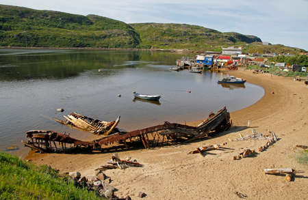 harbour in village Teriberka in Murmansk region of Russia Stock Photo