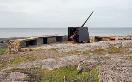 the soviet time artillery at the shore of Barents Sea nearby Teriberka. this photo was maden in open place with the free access Stock fotó