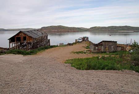 pier and water line in village Teriberka, Russia Stock Photo