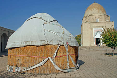 the traditional yurt and Ruhabad Mausoleum in the uzbek city Samarqand