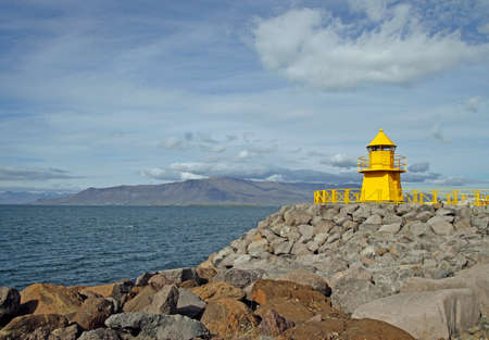 Lighthouse at the entrance to Reykjavik harbor in Iceland